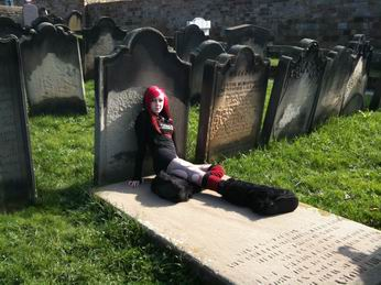 Photo of girl goth on a gravestone in St. Mary's Churchyard
