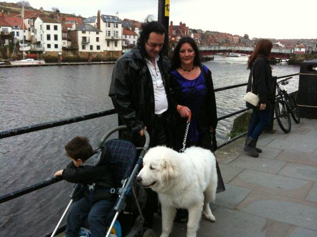A Gothic couple with a large white dog near Whitby Harbour