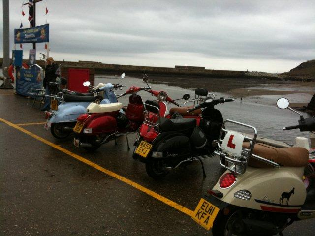 Photo of some scooters by the harbourside in Whitby