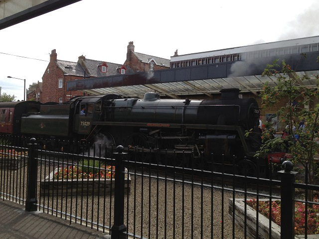 A photo of The green Knight steam train at Whitby Station