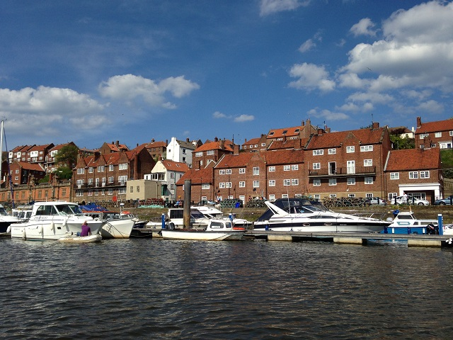 photo of boats moored