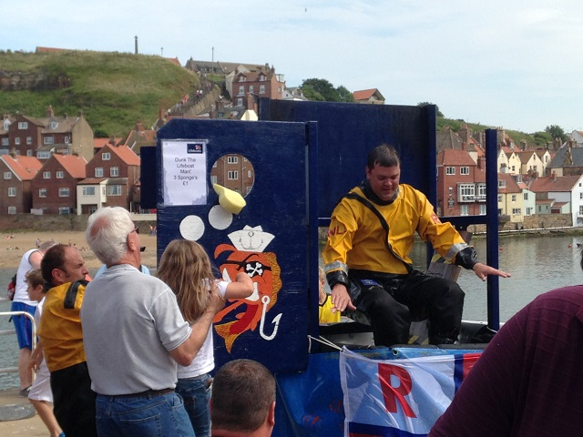 a photo of a lifeboat man about to take a plunge